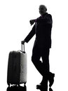 Senior business man traveler traveling waiting silhouette one caucasian checking time white background Stock Photos