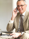 Senior business man using cell phone Royalty Free Stock Photos