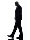 Senior business man walking silhouette Stock Photography
