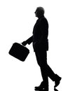 Senior business man walking silhouette one caucasian white background Stock Photos