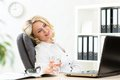 Senior business woman relaxing at work in office middle aged businesswoman Royalty Free Stock Photos