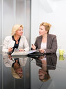 Senior business women meeting two in a modern room Royalty Free Stock Photography