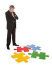 Senior businessman assembling a jigsaw puzzle Royalty Free Stock Photo