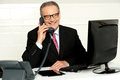 Senior businessman attending phone call Royalty Free Stock Photo