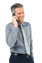 Senior businessman conversing on phone portrait of smiling talking with cellphone isolated white background Stock Images