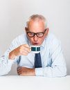 Senior businessman drinking coffee on grey background Royalty Free Stock Photos