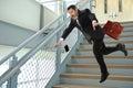 Senior businessman falling on stairs hispanic Royalty Free Stock Photography