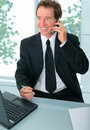 Senior Businessman Finishing Work In Office Royalty Free Stock Photos