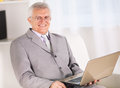Senior businessman happy working on laptop Royalty Free Stock Image