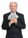 Senior businessman holding group of dollars dollar bills on a white background Royalty Free Stock Image
