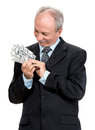 Senior businessman holding group of dollars dollar bills on a white background Stock Photo