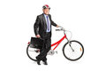 Senior businessman posing next to a bike Stock Photography