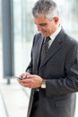 Senior businessman texting using mobile phone Royalty Free Stock Image