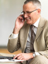 Senior businessman using cell phone Stock Photos