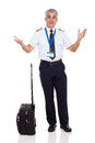 Senior captain surprised airline with facial expression on white background Royalty Free Stock Images