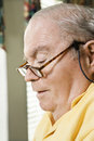image photo : Senior Caucasian man with reading glasses.