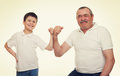 Senior and children show muscle hands Royalty Free Stock Photo