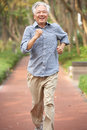 Senior Chinese Man Jogging In Park Royalty Free Stock Image