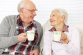 image photo : Senior citizen couple drinking