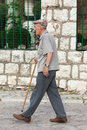 Senior citizen sarajevo bosnia and herzegovina august with walking cane walks on the street on bascarsija the old town very Stock Image