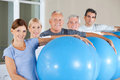 Senior citizens holding gym balls Stock Images