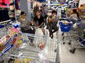 Senior citizens sit on chairs while waiting in a special lane dedicated for them at a grocery store in Antipolo City.