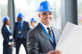 Senior construction engineer holding blue print Stock Photography