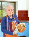 Senior cooking Royalty Free Stock Photos