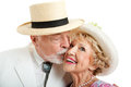 Senior couple from the american south he s kissing her on the cheek white background Royalty Free Stock Image