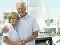 Senior couple arm in arm smiling portrait Royalty Free Stock Photos