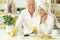 Senior couple  in a bathrobes  with tea Royalty Free Stock Photo