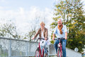 Senior couple with bicycles on bridge Royalty Free Stock Photo