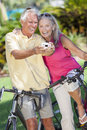 Senior Couple Bicycles Taking Digital Camera Picture Royalty Free Stock Photo