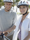 Senior couple with bicycles on tropical beach portrait of happy Royalty Free Stock Photo