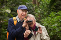 Senior Couple with Binoculars Royalty Free Stock Photo