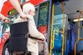 Senior couple boarding bus using wheelchair access ramp horizontal image of Royalty Free Stock Photography