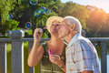 Senior couple with bubble blower. Royalty Free Stock Photo