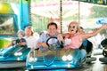 Senior couple in the bumper car at the fun fair Royalty Free Stock Photo