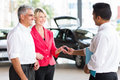 Senior couple buying car receiving key after a new Stock Images