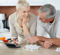 Senior couple calculating bills after shopping Royalty Free Stock Images