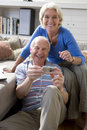Senior couple with camera smiling portrait Royalty Free Stock Photos