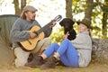 stock image of  Senior couple camping and enjoying music