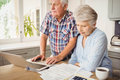 Senior couple checking their bills worried at home Stock Photography