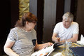 Senior couple choosing dish in restaurant a chinese Royalty Free Stock Images