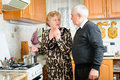 Senior couple cooking together at the kitchen Royalty Free Stock Photos