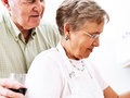 Senior couple cooking together photo of a Stock Images