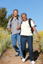 Senior couple on country hike Stock Photos