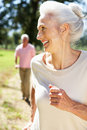 Senior couple on country run Royalty Free Stock Photos
