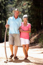 Senior couple on country walk Stock Image