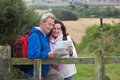 Senior couple on country walk looking at map Royalty Free Stock Images